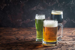 Different sorts of craft beer. Glasses with different sorts of craft beer on wooden table Royalty Free Stock Photos