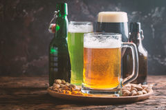 Different sorts of craft beer. Glasses with different sorts of craft beer on wooden table Stock Photography
