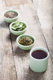 Different sorts of green tea. In a green cup stock photos
