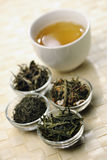 Different sorts of green tea and cup Royalty Free Stock Photos