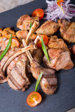 Different sorts of grilled meat. Served with vegetables Royalty Free Stock Photo