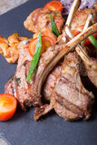 Different sorts of grilled meat. Served with vegetables Royalty Free Stock Images