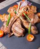 Different sorts of grilled meat. Served with vegetables Royalty Free Stock Photography