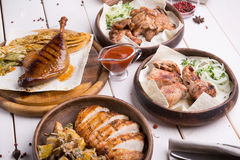 Different sorts of grilled meat. Set for a dinner Royalty Free Stock Photo
