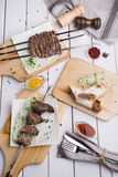 Different sorts of kebabs. Different sorts of grilled lamb kebabs and steaks Royalty Free Stock Image