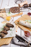 Different sorts of kebabs. Different sorts of grilled lamb kebabs and steaks Royalty Free Stock Photos