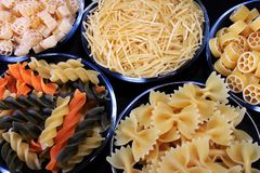 Different sorts of pasta. In glass bowls Royalty Free Stock Image