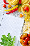 Different sorts of pasta, tomatoes and chili with recipe copy sp Royalty Free Stock Photo
