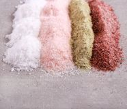 Different sorts of salt. Black, Indian, pink, Himalayan, and green sea salt Stock Images