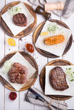 Different sorts of steaks. Different sorts of meat and fish steaks Stock Photo
