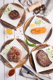 Different sorts of steaks. Different sorts of meat and fish steaks Stock Image