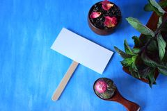 Different sorts of tea, mint and a white card. For a text in the middle stock photos