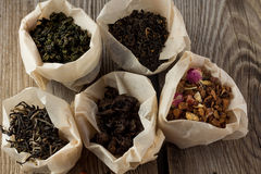 Different sorts of tea in paper bags. White, black, fruit tea, milk oolong, puer in paper bags Stock Images
