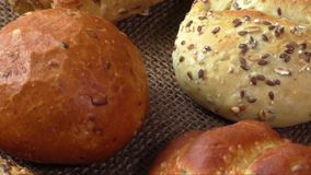 Different sorts of wholemeal breads and rolls, selective focus stock video