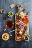 Different spanish embutidos on a table: jamon, chorizo, salami, cheese and wine. Top view Royalty Free Stock Image