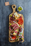 Different spanish embutidos on a table: jamon, chorizo, salami, cheese and wine. Top view Stock Photo
