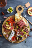 Different spanish embutidos on a table: jamon, chorizo, salami, cheese and wine. Top view Royalty Free Stock Photos