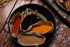 Different spices in bags. Royalty Free Stock Photos