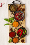 Different spices in bowls on table Stock Image