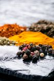 Different spices and herbs on a black slate. Indian spices. Ingredients for cooking. Healthy eating concept. Various spices on dar Royalty Free Stock Photo