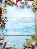 Different spices on old wooden table. Royalty Free Stock Photos