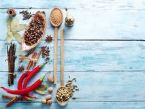 Different spices on old wooden table. stock images