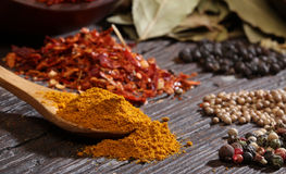 Different spices over a dark wood. royalty free stock photo