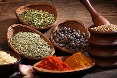 Different spices over a wood background. Royalty Free Stock Image