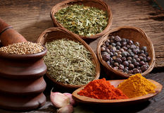 Different spices over a wood background. Stock Photo