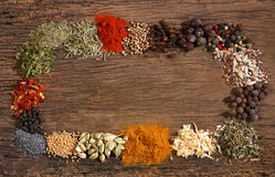 Different spices over a wooden background. Stock Photos
