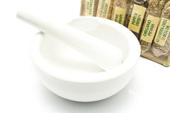 Different spices with porcelain mortar and pestle Royalty Free Stock Photography