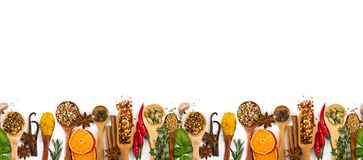 Different spices, seasonings and herbs isolated on white. Background. Seamless horizontal pattern royalty free stock photography