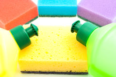 Different sponges and two bottles of detergent Royalty Free Stock Image