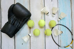 Different sport equipment. On wooden background Royalty Free Stock Photos