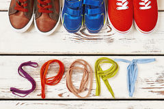 Different sport shoes and shoelaces. Stock Images