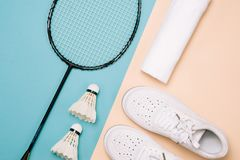 Different sports equipment on pastel color surface.  stock photo