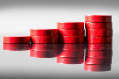 Different stacks of red wooden slices, concept finance Royalty Free Stock Photography