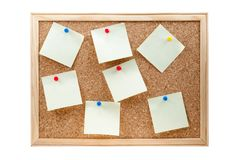 Different sticky notes on a cork board isolated. On a white background Royalty Free Stock Images