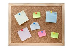 Different sticky notes on a cork board isolated. On a white background Stock Photo