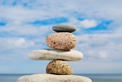 Different stones. Four different stones in a pile on a beach in the summer at midday Stock Photo