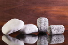 Different stones on a glass desk Royalty Free Stock Photo