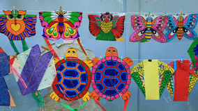 Different styles of animal kites hanging for sell Stock Photography