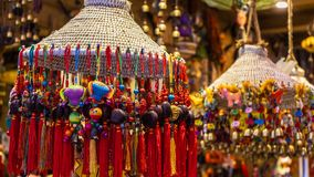 Colorful knotting decorative Chinese charms are hung and sold inside the shop at the street of Fenghuang Province in China royalty free stock image