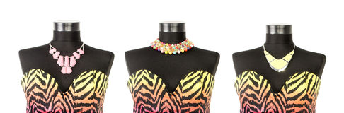 Different styling of a necklace on the same dress on mannequin. Stock Image