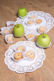 Different sugar cookies and apples on the table Royalty Free Stock Image