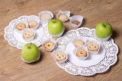 Different sugar cookies and green apples on the table Royalty Free Stock Photography