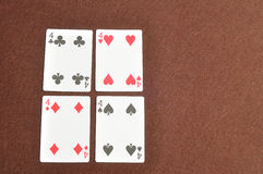 The different suit of the number 4 cards Stock Photography