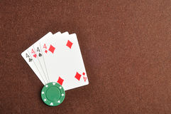 The different suit of the number 4 cards Stock Image