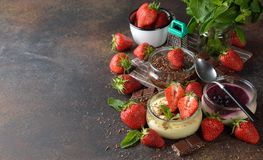 Different summer cheesecakes in jars Stock Photo