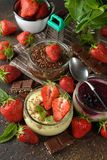 Different summer cheesecakes in jars Royalty Free Stock Photography